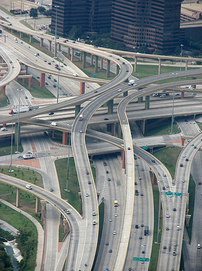 birds eye view of highway with a lot of roads crossing eachother in multiple layers