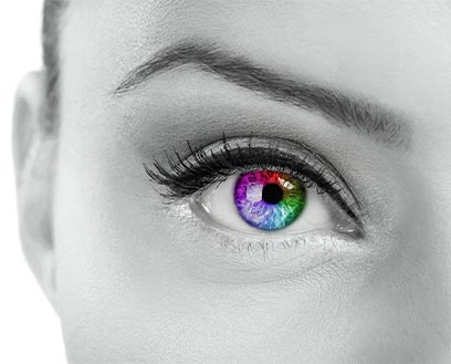 close up of female eye with all colors of the spectrum