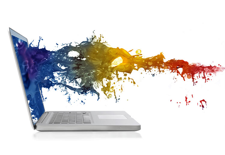 Laptop with color spectrum representing webdesign by marketing spectrum